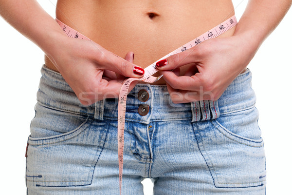 Close up of womans waist and tape measure Stock photo © RTimages