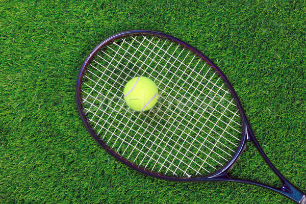 Stock photo: Tennis raquet and ball on grass