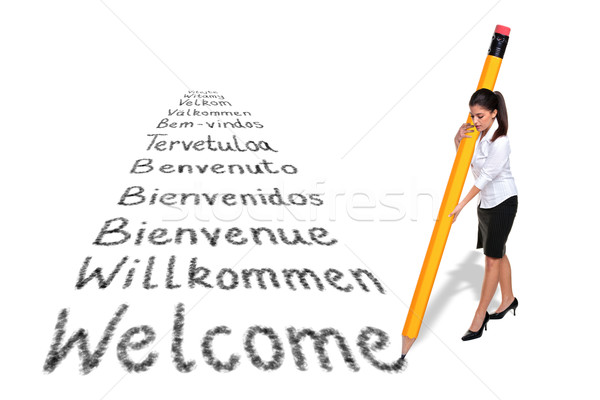 Stock photo: Businesswoman writing Welcome in various languages with a giant