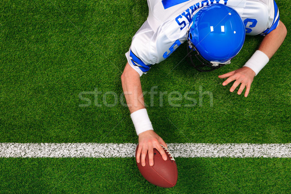 Overhead American football player one handed touchdown Stock photo © RTimages