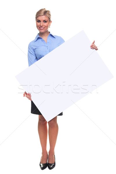 Blond woman holding a blank message board. Stock photo © RTimages