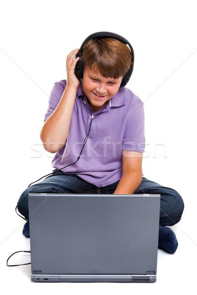 Estudante laptop fones de ouvido isolado foto 11 anos Foto stock © RTimages