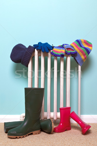 Childrens hats, gloves and wellies by radiator Stock photo © RTimages
