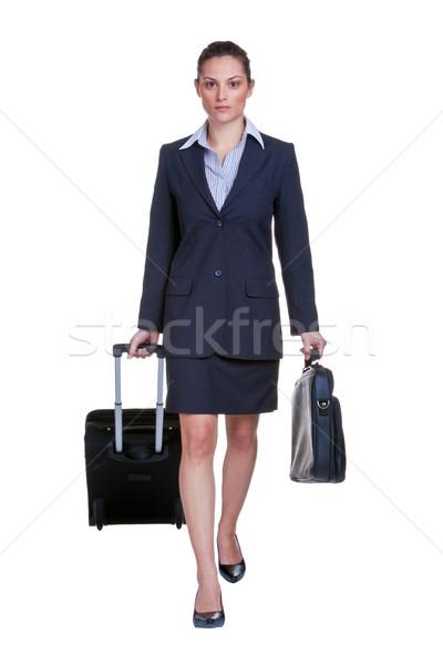 Zakenvrouw reiziger pak koffer aktetas geïsoleerd Stockfoto © RTimages