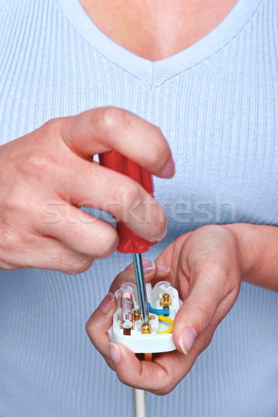Célibataire électrique plug photo femme électricité Photo stock © RTimages