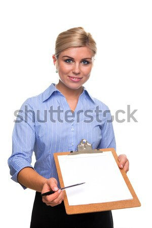 Woman holding a clipboard with blank paper cut out. Stock photo © RTimages