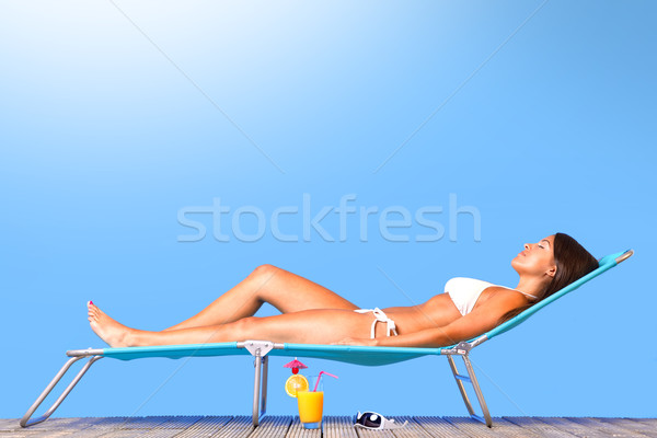 Beautiful woman sunbathing Stock photo © RTimages