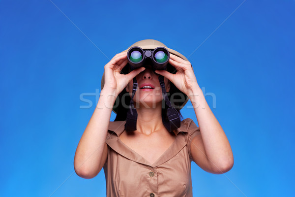 Woman in safari hat looking through binoculars  Stock photo © RTimages