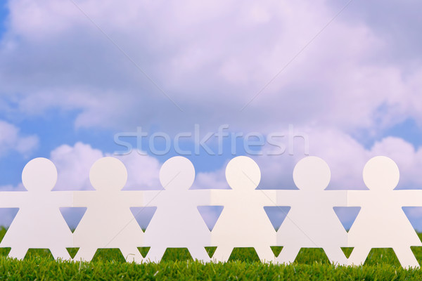 Paper women holding hands Stock photo © RTimages