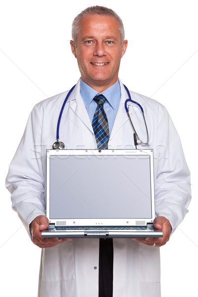 Stock photo: Doctor holding laptop clipping path for screen.