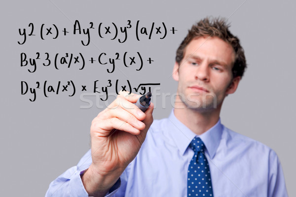 Teacher writing a maths equation. Stock photo © RTimages