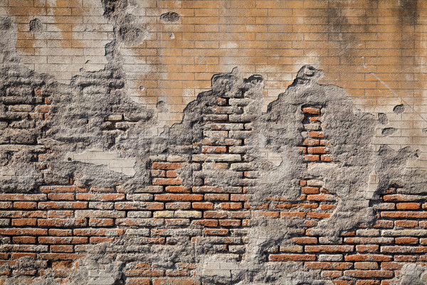 Weathered plaster and brick wall textured background Stock photo © RTimages
