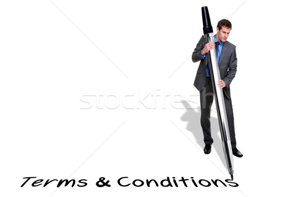 Businessman writing Terms and Conditions with a giant pen Stock photo © RTimages
