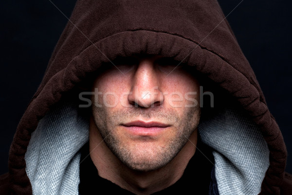Evil looking hooded man Stock photo © RTimages