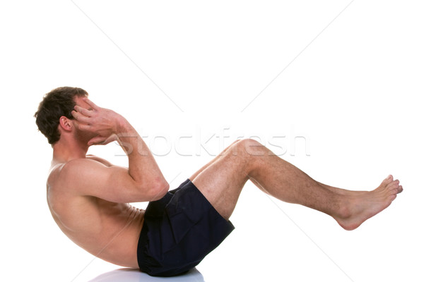 Man doing a sip up stomach crunch Stock photo © RTimages