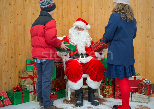Boy and Girl receiving gifts from Santa Stock photo © RTimages