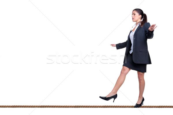 деловая женщина ходьбе туго натянутый канат изолированный белый костюм Сток-фото © RTimages