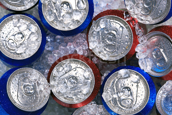 Stock photo: Cans of drink on crushed ice