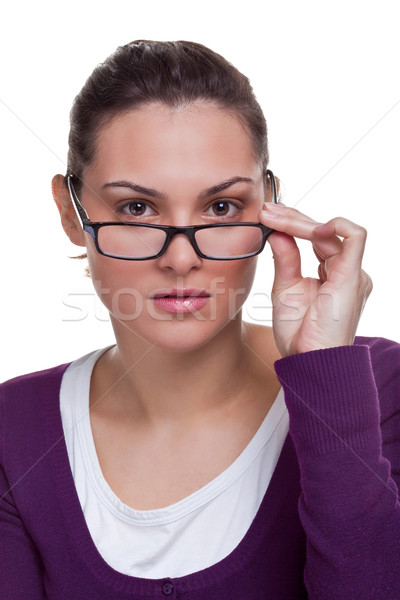 Brunette adjusting her glasses Stock photo © RTimages