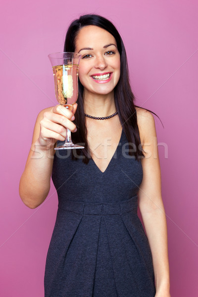 Woman raising a glass of champagne Stock photo © RTimages