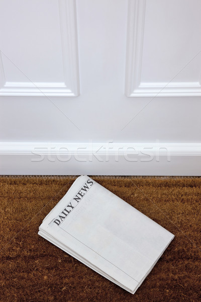 Blank newspaper lying on a doormat. Stock photo © RTimages