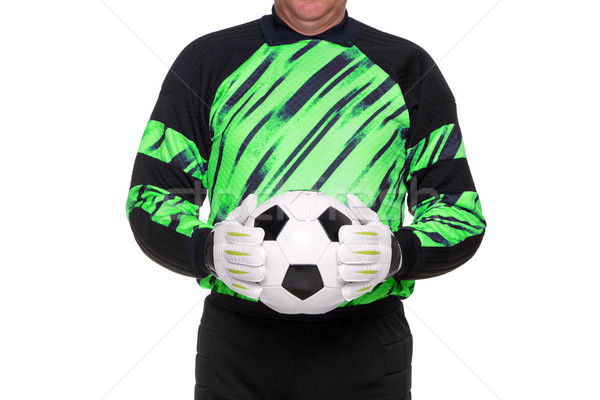 Football goalkeeper holding ball isolated Stock photo © RTimages