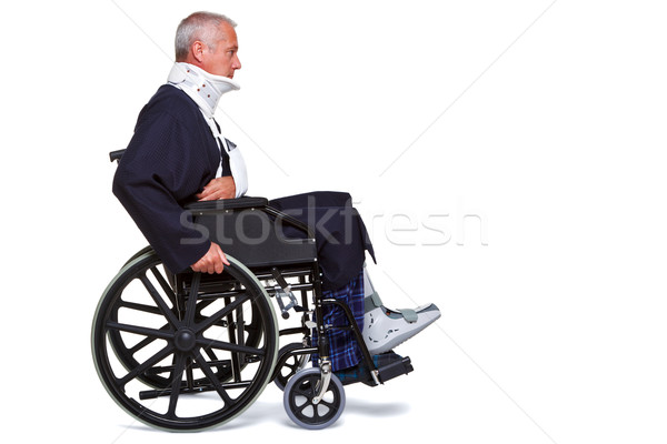 Injured man in wheelchair isolated Stock photo © RTimages