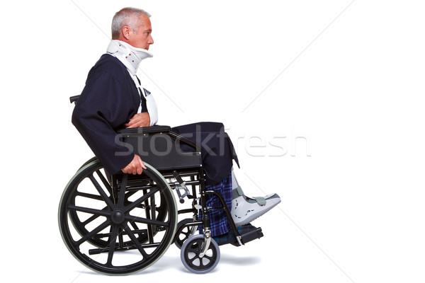 Uomo sedia a rotelle isolato foto spingendo Foto d'archivio © RTimages