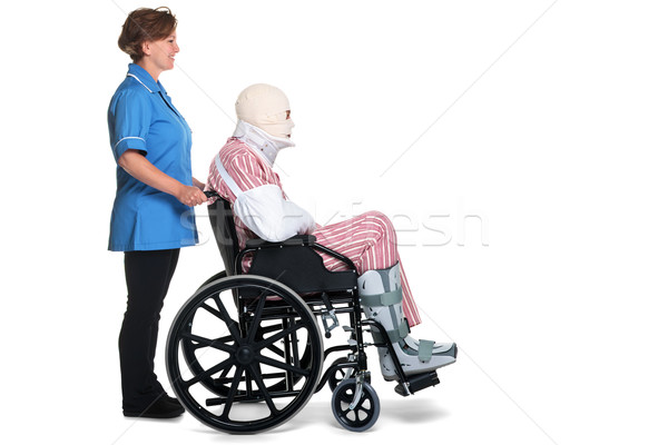 Injured man in wheelchair with nurse Stock photo © RTimages