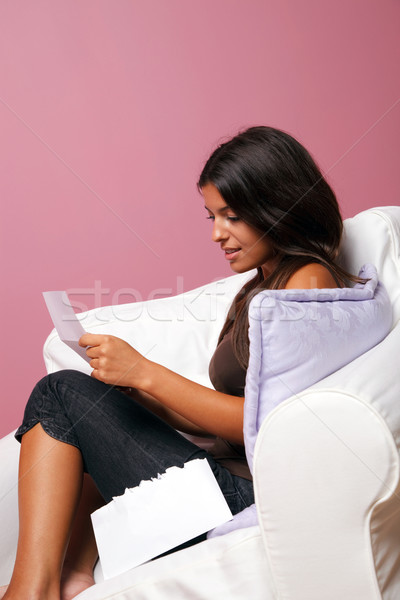 Women sat in an armchair reading a letter Stock photo © RTimages