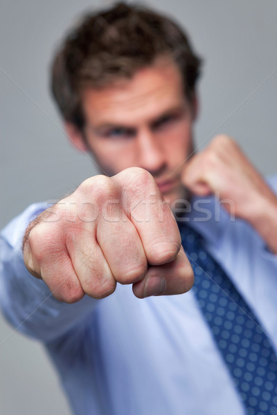 Businessman punching towards camera Stock photo © RTimages