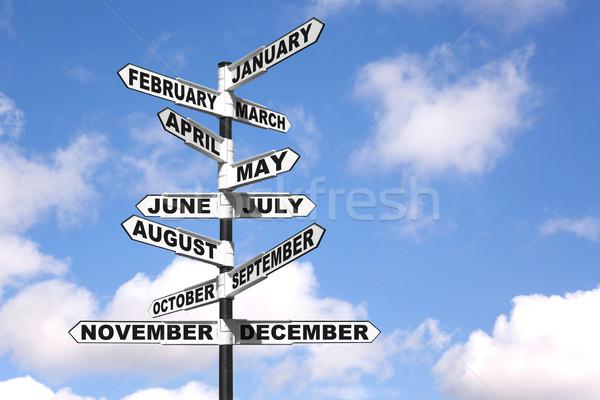 Сток-фото: месяцев · год · указатель · синий · облачный