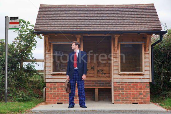 Businessman standing at a bus stop in pyjamas and slippers Stock photo © RTimages