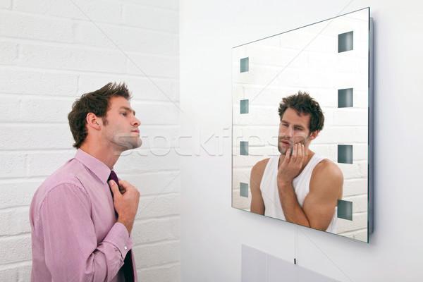 Dwa gotowy rano obraz człowiek lustra Zdjęcia stock © RTimages