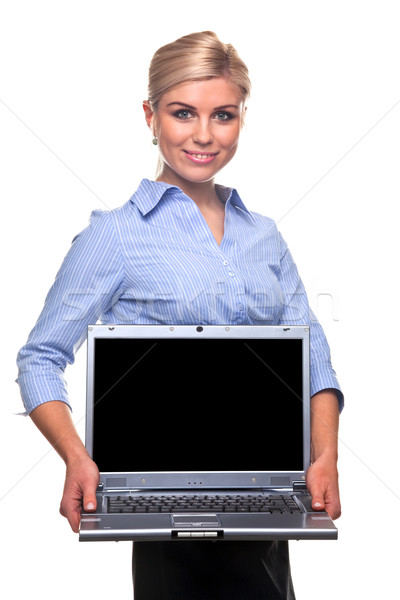 Blond busineswoman holding a laptop with copy space Stock photo © RTimages