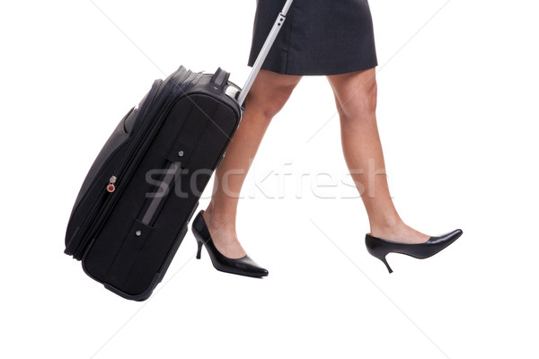 Businesswomans legs with suitcase Stock photo © RTimages