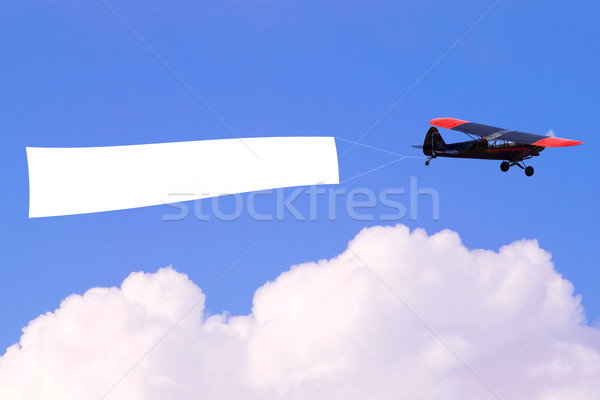 Airplane flying blank banner Stock photo © RTimages