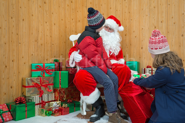 Children visiting Santas grotto Stock photo © RTimages