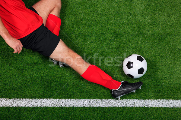 Overhead football player sliding Stock photo © RTimages