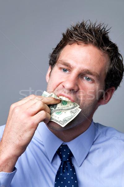 бизнесмен начинка деньги рот банка отмечает Сток-фото © RTimages