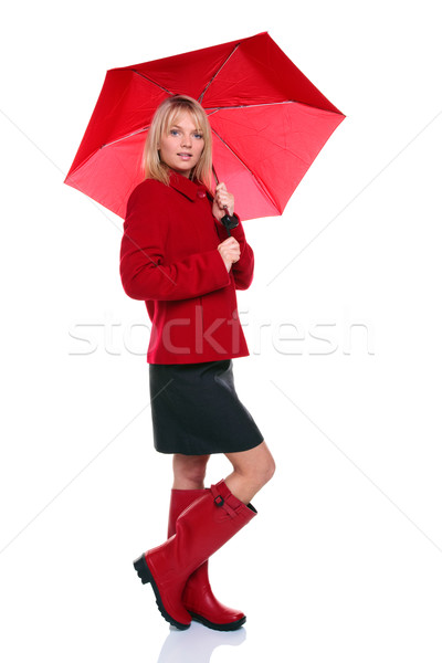 Woman in red coat, boots and umbrella Stock photo © RTimages