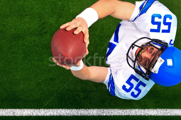 Overhead American football player catching the ball Stock photo © RTimages