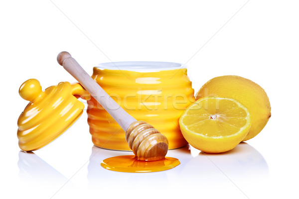 Honey and lemon isolated on a white background. Stock photo © RTimages