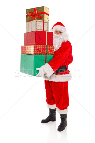 Father Christmas holding a stack of presents, isolated on white Stock photo © RTimages