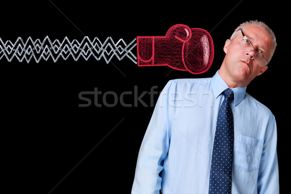 Mature businessman knockout punch Stock photo © RTimages