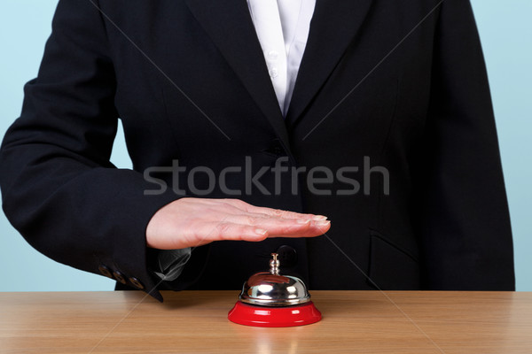 Woman ringing a reception bell Stock photo © RTimages