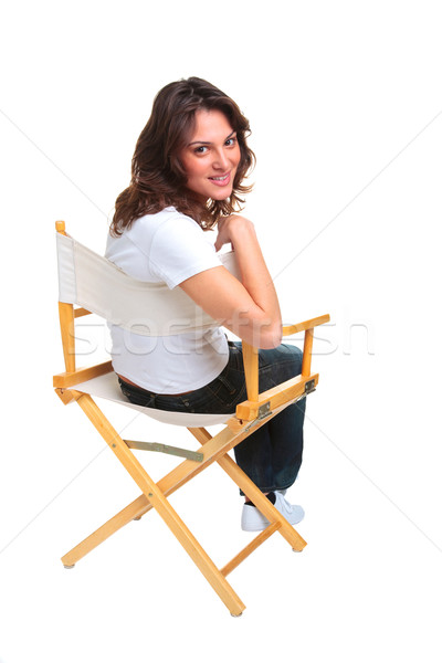 Woman sat on a chair looking back Stock photo © RTimages