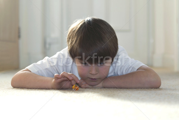 Boy playing marbles #1 Stock photo © RTimages