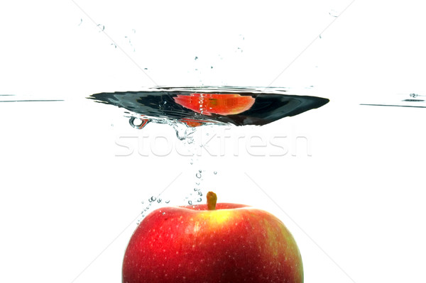 Sinking apple Stock photo © RTimages