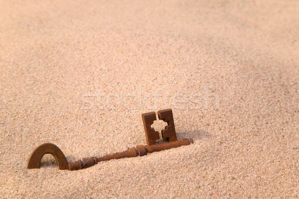 Rusty old key in sand Stock photo © RTimages